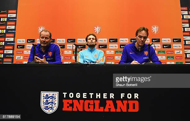The Netherlands Coach Danny Blind and Daley Blind talk during a press conference prior to the International Friendly match against England at Wembley...