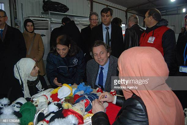 The Netherlands' Foreign Minister Bert Koenders with the delegations visit a refugee camp where Syrian refugees shelter in Gaziantep's Nizip district...