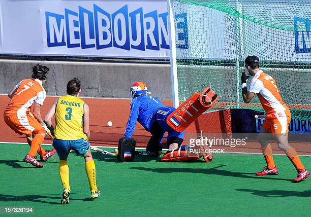 The Netherlands goalkeeper Jaap Stockman successfully deflects the ball during their Pool B match against Australia at the Men's Hockey Champioships...