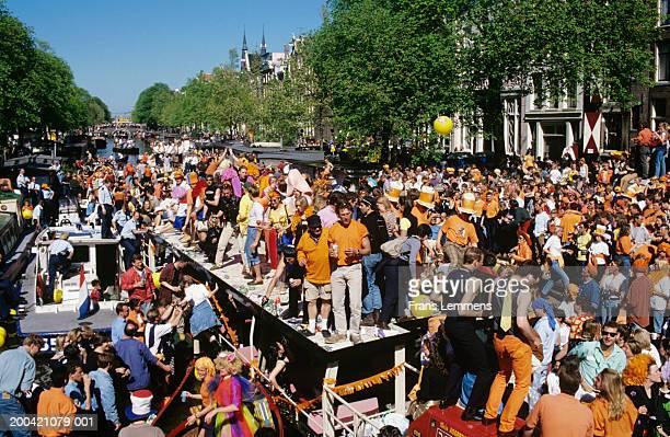 The Netherlands, Holland, Amsterdam, people celebrating on boats