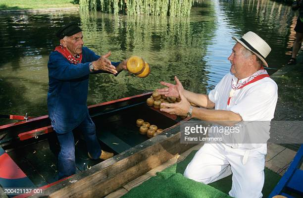 The Netherlands, Holland, Edam, men unloading cheese from canal boat