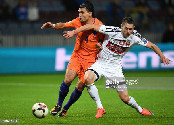 The Netherlands' Karim Rekik and Belarus' forward Nikolai Signevich vie for the ball during the FIFA World Cup 2018 qualification football match...