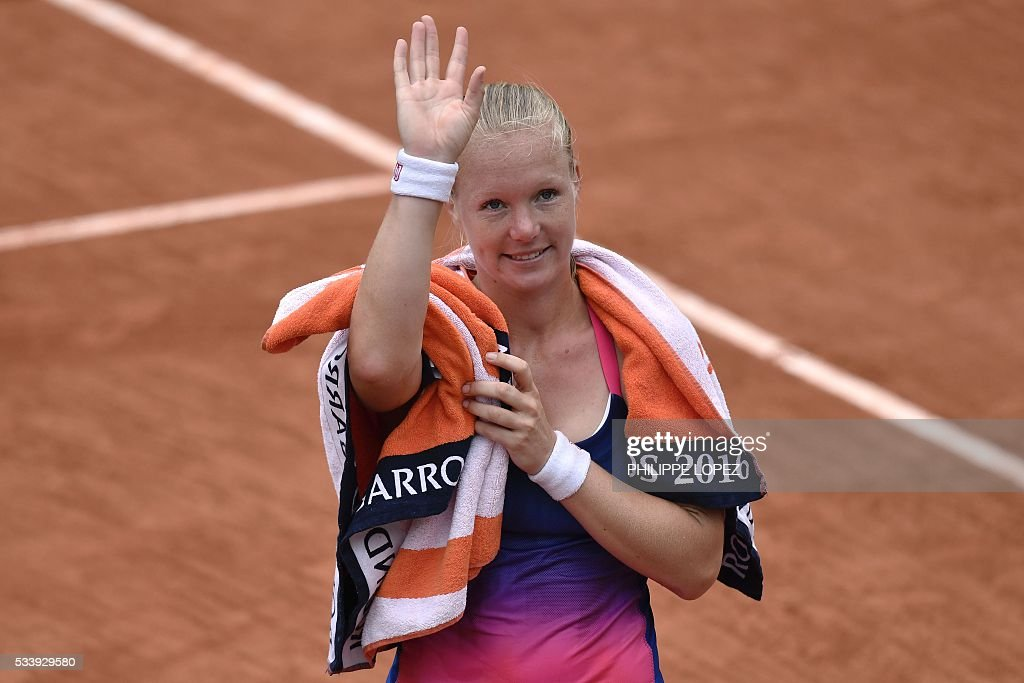 The Netherlands' Kiki Bertens celebrates after winning her women's first round match against Germany's Angelique Kerber at the Roland Garros 2016 French Tennis Open in Paris on May 24, 2016. / AFP / PHILIPPE