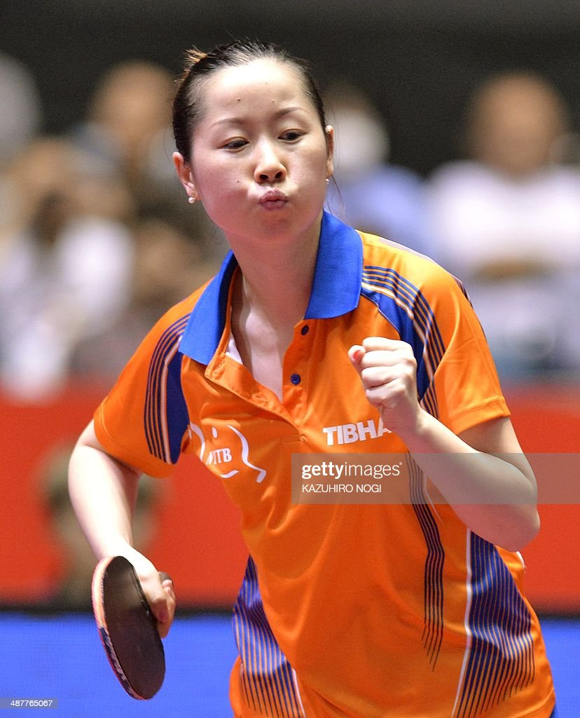 The Netherlands' <a gi-track='captionPersonalityLinkClicked' href=/galleries/search?phrase=Li+Jie+-+Table+Tennis+Player&family=editorial&specificpeople=12783702 ng-click='$event.stopPropagation()'>Li Jie</a> reacts after her point against Taiwan's Cheng I-Ching during their match in the women's team championship division knockout rounds at the 2014 World Team Table Tennis Championships in Tokyo on May 2, 2014.