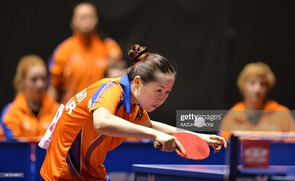 The Netherlands' Li Jie returns a shot against Russia's Polina Mikhailova during their match in the women's team championship division group C at the 2014 World Team Table Tennis Championships in Tokyo on May 1, 2014. AFP PHOTO / KAZUHIRO NOGI