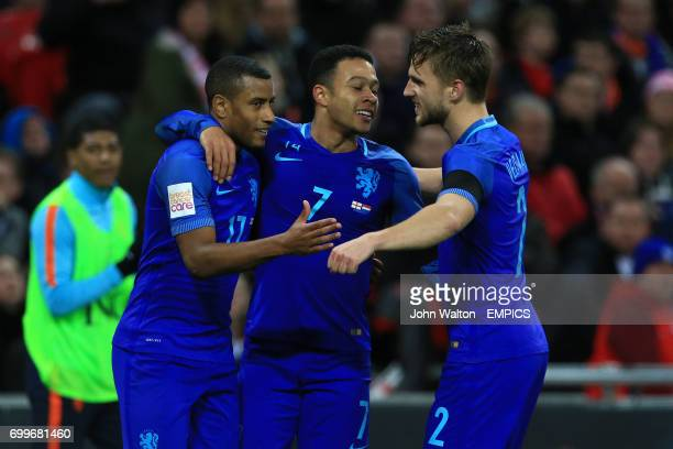 The Netherlands' Luciano Narsingh celebrates scoring his side's second goal of the game with team mates Memphis Depay and Joel Veltman reacts during...