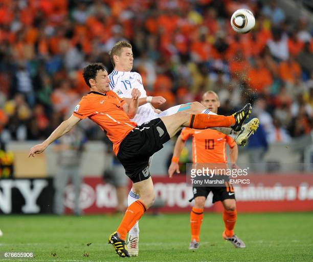 The Netherlands Mark Van Bommel and Slovakia's Juraj Kucka battle for the ball