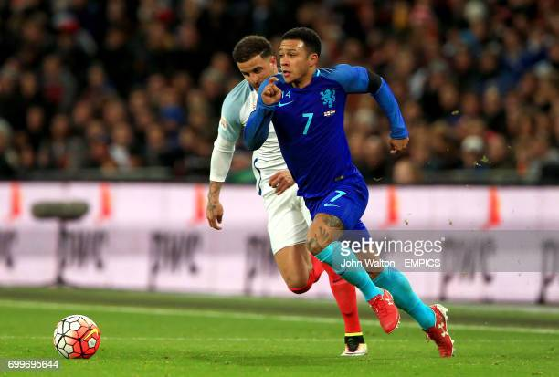The Netherlands' Memphis Depay in action with England's Kyle Walker