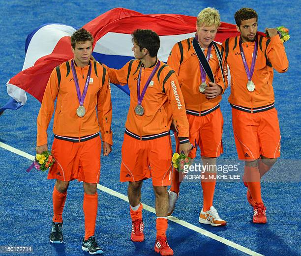 The Netherlands' players carry their bronze medals after the podium ceremony for the men's field hockey gold medal match Germany vs the Netherlands...