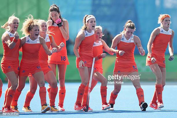 The Netherlands players celebrate during the penalthy shootout during the womens semifinal match between the Netherlands and Germany on Day 12 of the...