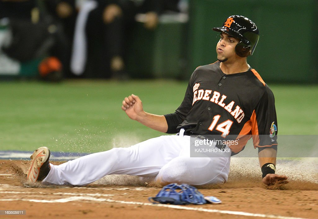 The Netherlands Randolph Oduber slides into home-plate against Cuba during the third inning of their second-round Pool 1 game in the World Baseball Classic tournament at Tokyo Dome on March 11, 2013.
