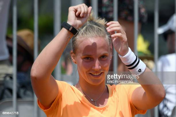 The Netherlands' Richel Hogenkamp celebrates after winning her tennis match against Serbia's Jelena Jankovic at the Roland Garros 2017 French Open on...