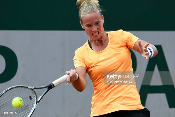 The Netherlands' Richel Hogenkamp returns the ball to Serbia's Jelena Jankovic during their tennis match at the Roland Garros 2017 French Open on May...