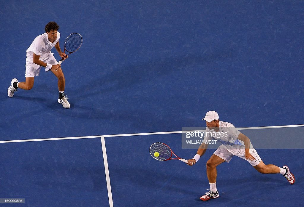 The Netherland's Robin Haase (L) and Igor Sijsling compete against Mike Bryan and his brother Bob of the US during the men's doubles final on day 13 of the Australian Open tennis tournament in Melbourne on January 26, 2013. AFP PHOTO / WILLIAM WEST IMAGE STRICTLY RESTRICTED TO EDITORIAL USE - STRICTLY NO COMMERCIAL USE