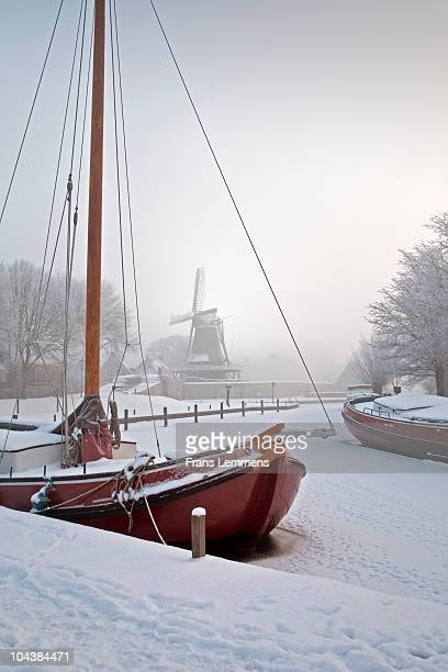 The Netherlands, Sailing ships in frozen canal