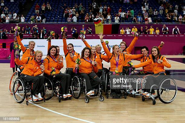 The Netherlands team celebrate winning the Bronze Medal in the Women's Wheelchair Basketball on day 9 of the London 2012 Paralympic Games at...