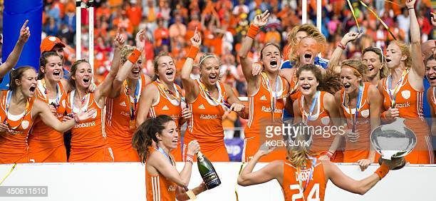 The Netherlands' team celebrates after defeating Australia to win the World Cup in the women's tournament of the Field Hockey World Cup in The Hague...
