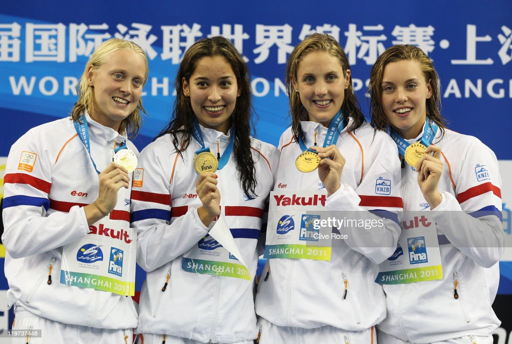 The Netherlands team with Femke Heemskerk, Inge Dekker, Ranomi Kromowidjojo and Marleen Veldhuis pose with their gold medals after winning the Women's 4x100m Freestyle Relay during Day Nine of the 14th FINA World Championships at the Oriental Sports Center on July 24, 2011 in Shanghai, China. USA won silver and Germany won bronze.