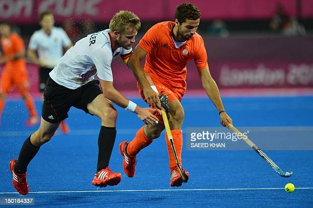 The Netherlands' Valentin Verga vies with Germany's Maximilian Mueller during the men's field hockey gold medal match Germany vs the Netherlands at...