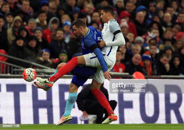 The Netherlands' Vincent Janssen and England's Chris Smalling battle for the ball during the International Friendly match at Wembley Stadium London