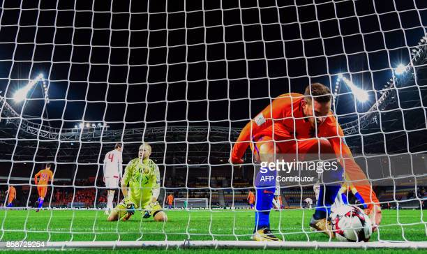 The Netherlands' Vincent Janssen grabs the ball after The Netherlands' Davy Propper scored a goal during the FIFA World Cup 2018 qualification...