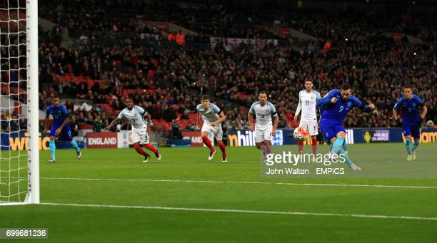 The Netherlands' Vincent Janssen scores his side's first goal of the game from a penalty during the International Friendly match at Wembley Stadium...