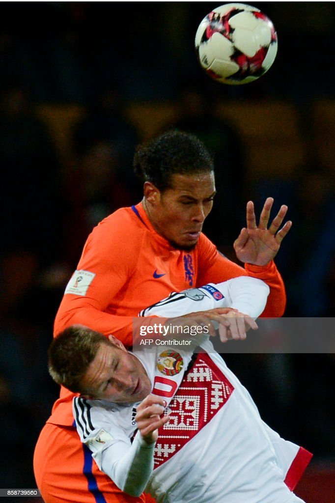 The Netherlands' Virgil Van Dijk and Belarus' forward Anton Saroka vie for the ball during the FIFA World Cup 2018 qualification football match between Belarus and the Netherlands in Borisov, outside Minsk, on October 7, 2017. /