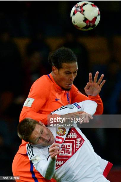 The Netherlands' Virgil Van Dijk and Belarus' forward Anton Saroka vie for the ball during the FIFA World Cup 2018 qualification football match...
