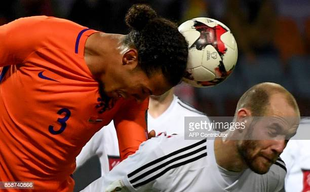 The Netherlands' Virgil Van Dijk and Belarus' midfielder Ivan Maevski vie for the ball during the FIFA World Cup 2018 qualification football match...