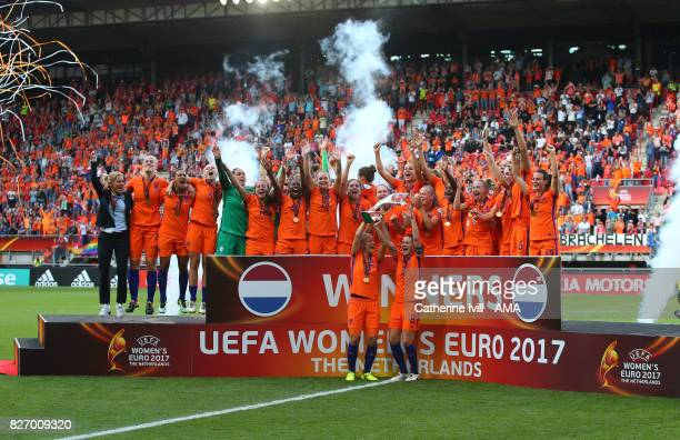 The Netherlands Women celebrate with the trophy on the podium after the UEFA Women's Euro 2017 final match between Denmark and Netherlands at De...