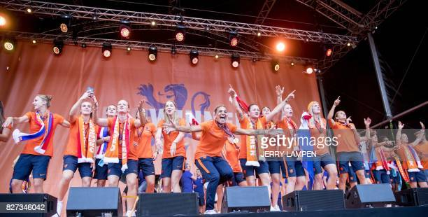 The Netherland's women's soccer team celebrate on stage after winning the UEFA Women's Euro 2017 final soccer match between The Netherlands and...