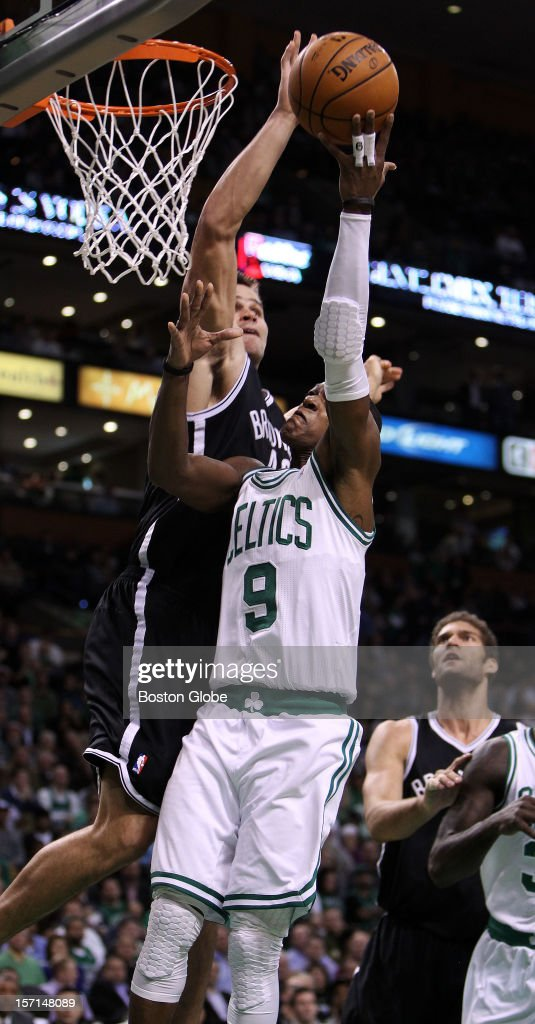 The Nets' Kris Humphries blocks a second quarter layup attempt by the Celtics' Rajon Rondo as the Boston Celtics hosted the Brooklyn Nets in a regular season NBA game at the TD Garden.