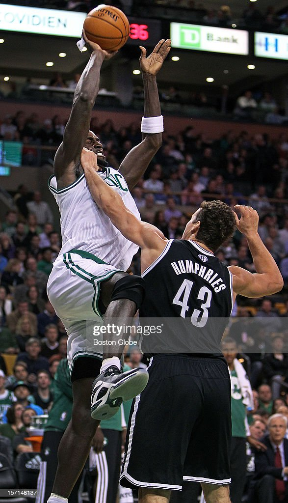 The Nets' Kris Humphries hits the Celtics' Kevin Garnett hard as he goes up for a shot late in the first half as the Boston Celtics hosted the Brooklyn Nets in a regular season NBA game at the TD Garden. The play touched off a melee.