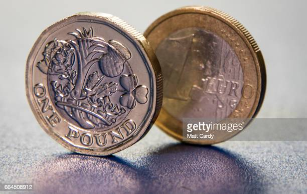 The new £1 pound coin is seen alongside a euro coin on April 4 2017 in Bath England Currency experts have warned that as the uncertainty surrounding...