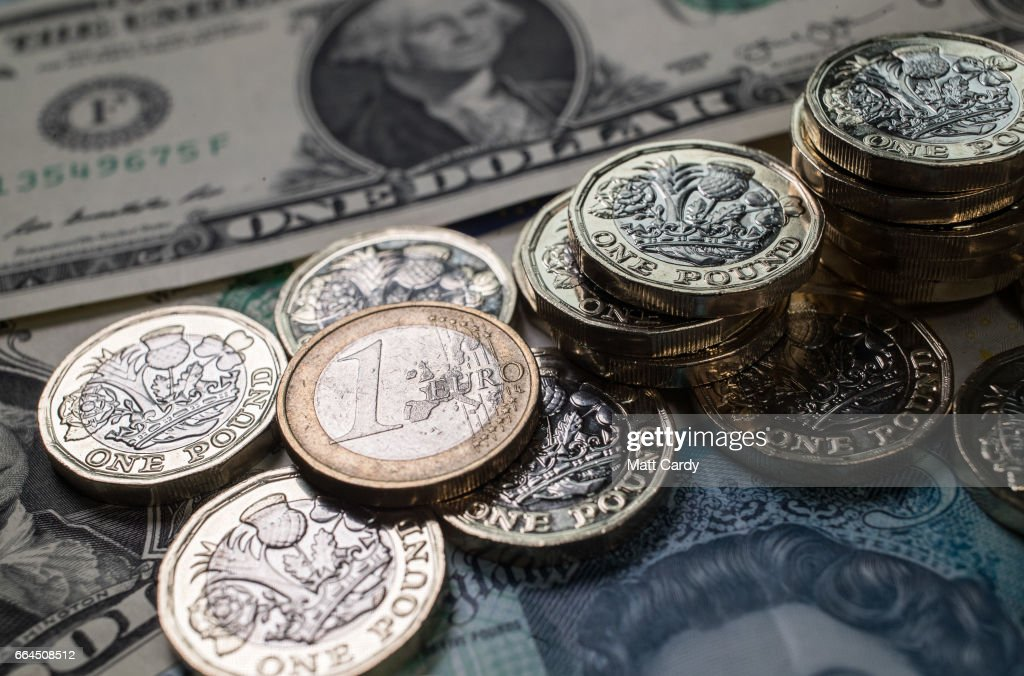 The new £1 pound coin is seen alongside US dollar bills and euro coins on April 4, 2017 in Bath, England. Currency experts have warned that as the uncertainty surrounding Brexit continues, the value of the British pound, which has remained depressed against the US dollar and the euro since the UK voted to leave in the EU referendum, is likely to fluctuate.