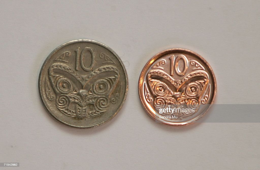 The new 10 cent piece (R) which began circulation for the first time today sits next to the older, larger coin, July 31, 2006 in Auckland, New Zealand. From today the 50, 20 and 10 cent pieces will be replaced by lighter, smaller versions. The five cent piece will cease to exist after the three month changeover phase.