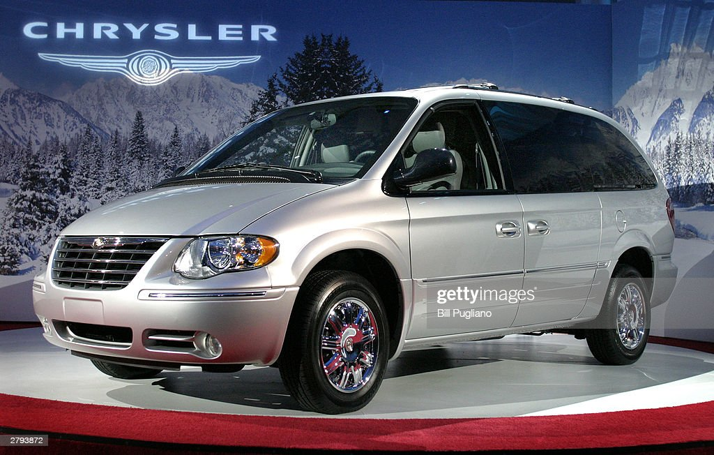 daimlerchrysler unveils new minivans with stow 39 n go feature getty images. Black Bedroom Furniture Sets. Home Design Ideas