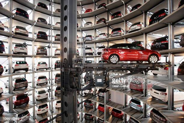 The new 2011 Volkswagen Golf Cabrio is lifted into one of two storage towers at the Autostadt customer reception center at the Volkswagen factory on...