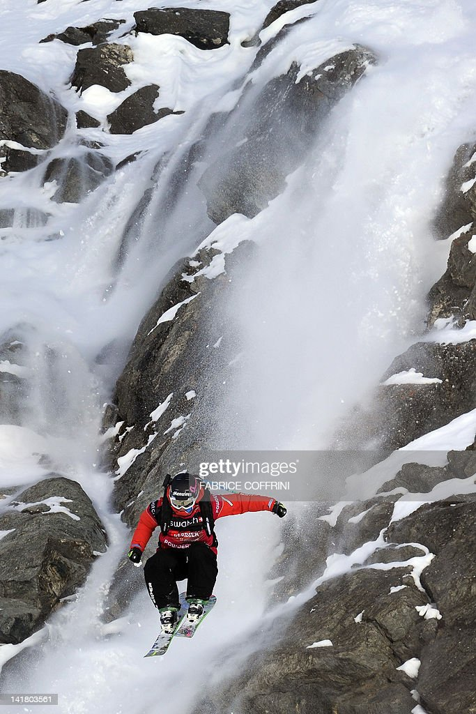 The new 2012 Freeride World Champion at the Men's ski event, Sweden's Reine Barkered competes in the Bec de Rosses mountain during the Xtreme Freeride World Tour final on March 24, 2010 above the Swiss Alps resort of Verbier. AFP PHOTO / FABRICE COFFRINI