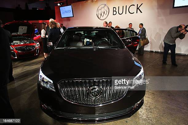 The new 2014 Buick LaCrosse is displayed at a launch party for new versions of General Motors Company Buick brand cars on March 26 2013 in New York...