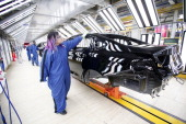 The new 2015 Chrysler 200 is shown in the Paint shop at the Sterling Heights Assembly Plant March 14 2014 in Sterling Heights Michigan The plant...