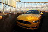 The new 2015 Mustang convertible is viewed on top of the observation deck at the Empire State Building in honor of 50 years of the Ford Mustang on...