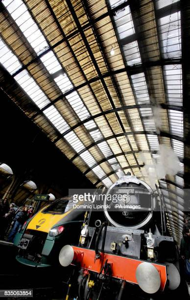 The new 3m steam locomotive Tornado sits next to a modern train after arriving at London King's Cross station