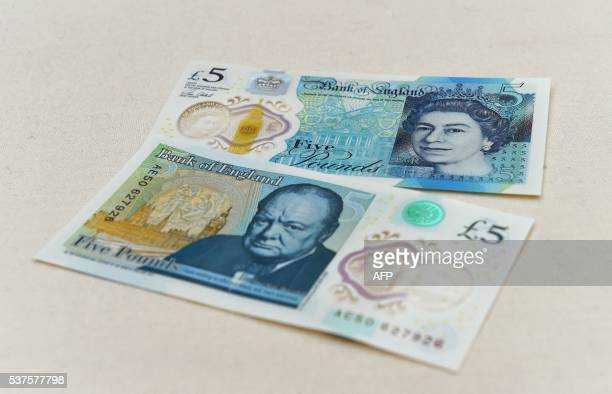 The new £5 banknote bearing the image of wartime leader Winston Churchill is on show at its unveiling by the Bank of England at Blenheim Palace in...