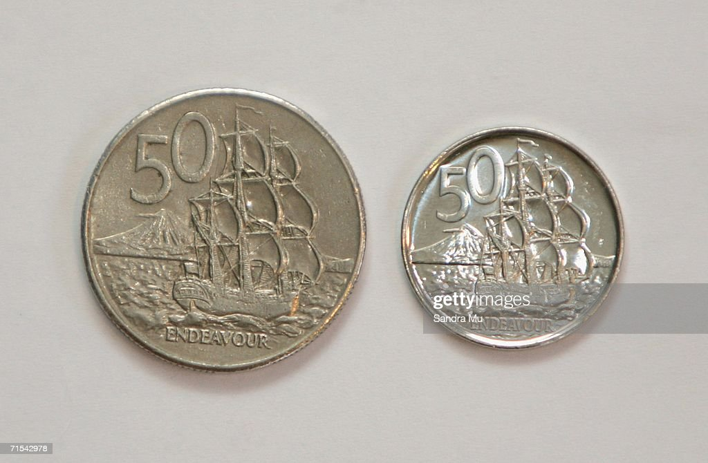 The new 50 cent piece (R) which began circulation for the first time today sits next to the older, larger coin, July 31, 2006 in Auckland, New Zealand. From today the 50, 20 and 10 cent pieces will be replaced by lighter, smaller versions. The five cent piece will cease to exist after the three month changeover phase.