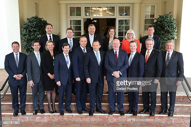 The new Abbott Ministry poses for media with Prime Minister Tony Abbott and GovernorGeneral Peter Cosgrove at Government House on December 23 2014 in...
