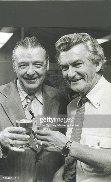 The new ACTU President Cliff Dolan shares a drink with his predecessor Bob Hawke on the day he took over Hawke's old job Dolan drank beer while Hawke...