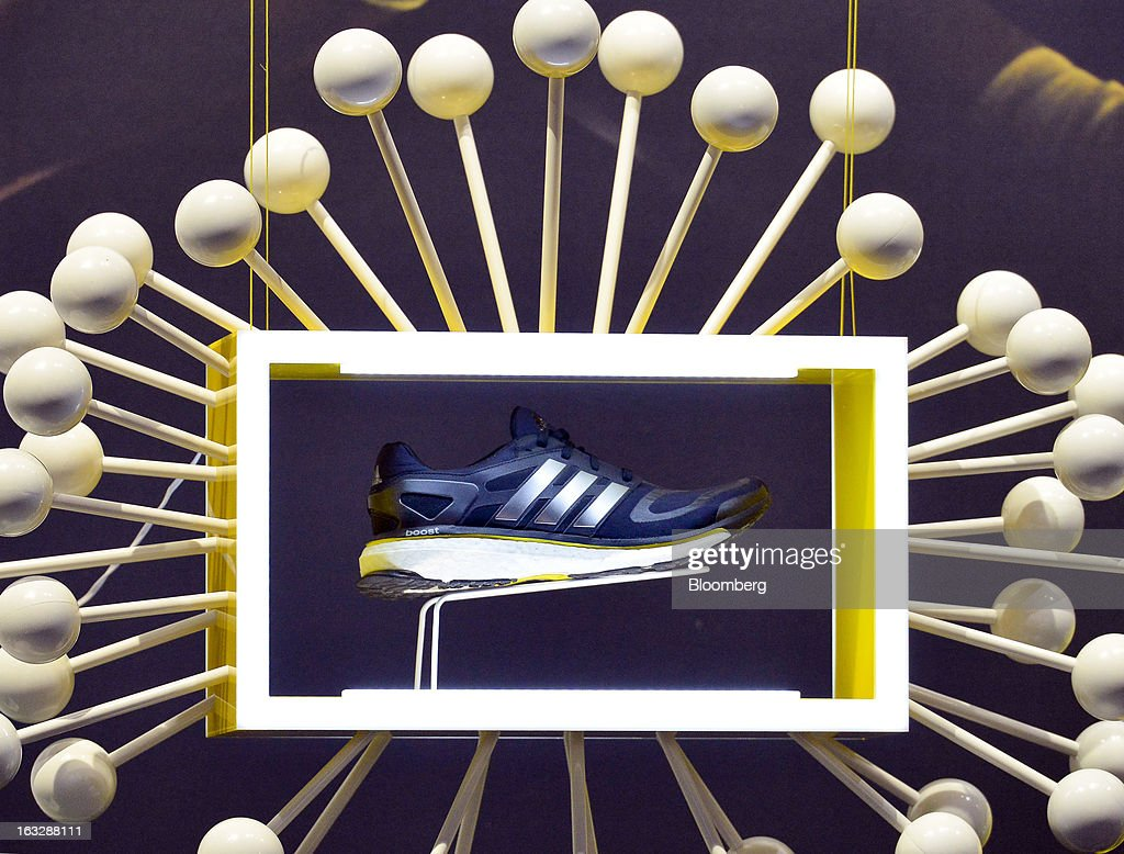 The new Adidas Energy Boost running shoe from Adidas AG is seen on display during the company's earnings news conference in Herzogenaurach, Germany, on Thursday, March 7, 2013. Adidas AG, the world's second-largest sporting-goods maker, forecast higher sales and profit this year and raised its dividend by 35 percent as it targets fast-growing emerging markets and introduces new products. Photographer: Guenter Schiffmann/Bloomberg via Getty Images