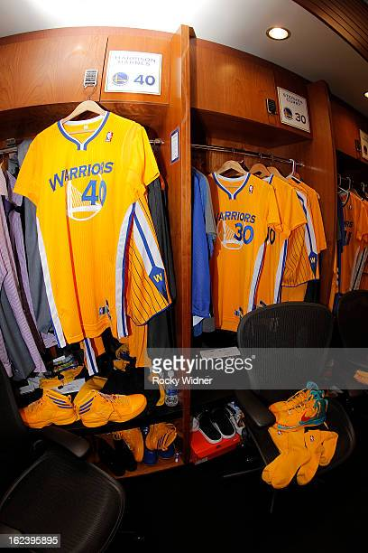 The new Adidas shortsleeved jerseys of Harrison Barnes and Stephen Curry of the Golden State Warriors hang in the locker room before the team debuted...
