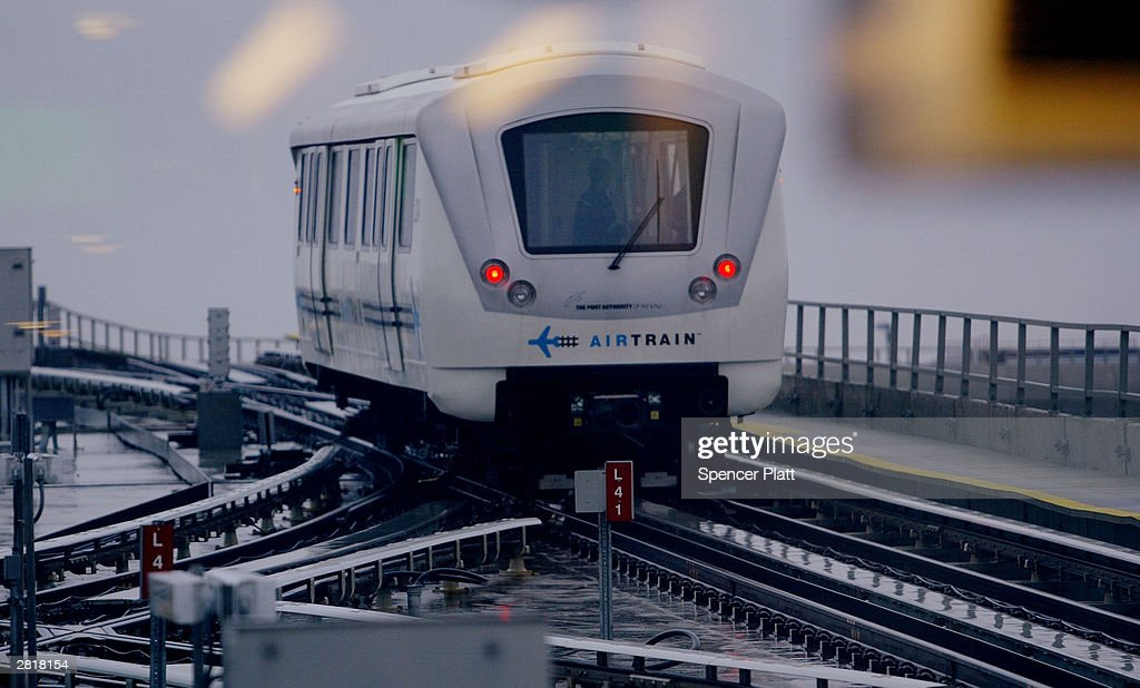 The new AirTrain rail service exits a station December 17 2003 at JFK Airport in New York City AirTrain is a light rail service that connects John F...